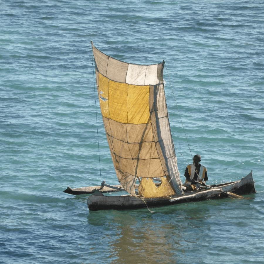 Madagascar citizen on a small boat